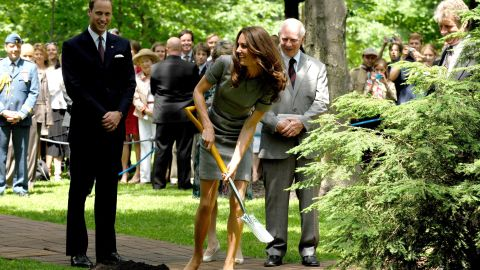 Catherine shovels soil during a tree-planting ceremony in Ottawa in July 2011.