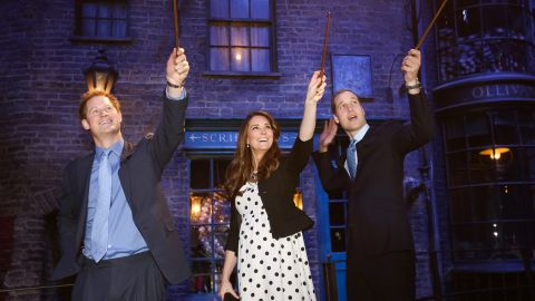 """In April 2013, Harry, Catherine and William make magic on the set used to depict Diagon Alley in the """"Harry Potter"""" films."""