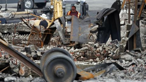 An emergency worker works at the site of the train wreckage on July 9.