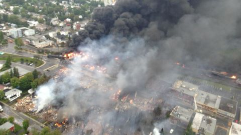 """An aerial photo from the Quebec Provincial Police shows the aftermath of a <a href=""""http://www.cnn.com/2013/07/10/world/americas/canada-runaway-train/"""">train derailment explosion in Lac-Megantic, Quebec</a>, on Saturday, July 6. Quebec provincial authorities have found 20 bodies, and 30 more are missing and """"most probably dead."""""""