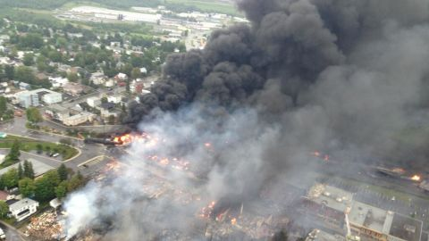 """An aerial photo from the Quebec Provincial Police shows the aftermath of a train derailment explosion in Lac-Megantic, Quebec, on Saturday, July 6. Quebec provincial authorities have found 20 bodies, and 30 more are missing and """"most probably dead."""""""