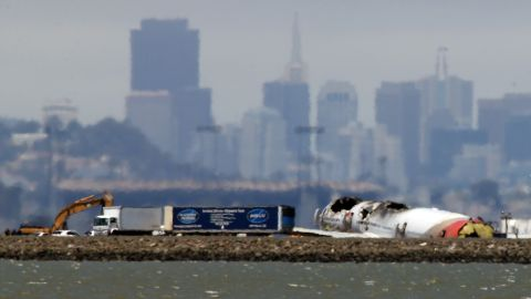 The wreckage of Asiana Airlines flight 214 sits on the runway at San Francisco International Airport on July 11, 2013 in San Francisco, California.