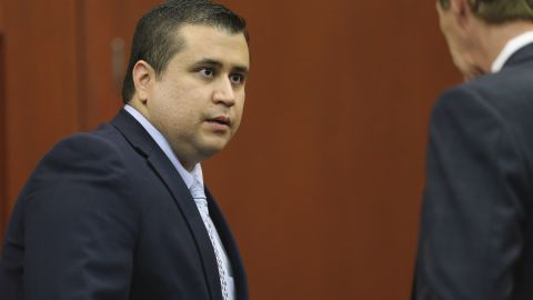 George Zimmerman speaks to his attorney Mark O'Mara after the jury left to deliberate during his trial in Seminole Circuit Court in Sanford, Florida. Friday, July 12.