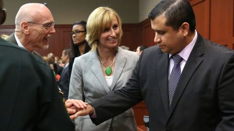 """George Zimmerman is congratulated by members of his defense team, Don West and Lorna Truett, after the not guilty verdict is read on Saturday, July 13, in Sanford, Florida. A jury of six women found him  not guilty in the shooting death of Trayvon Martin. <a href=""""http://www.cnn.com/2013/07/13/justice/gallery/zimmerman-trial-reaction/index.html"""" target=""""_blank"""">View photos of the public reaction to the verdict.</a>"""