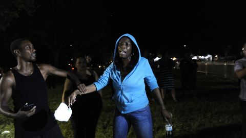 """A Trayvon Martin supporter rallies outside the courthouse on July 13. After Martin's death, <a href=""""http://www.cnn.com/2012/03/27/living/history-hoodie-trayvon-martin/index.html"""">protesters started wearing hoodies</a> in solidarity against racial profiling."""
