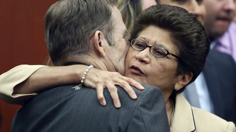 Robert Zimmerman Sr. and Gladys Zimmerman embrace after their son is found not guilty on July 13.