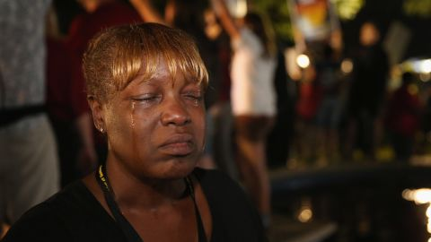 Tanetta Foster cries in front of the courthouse on July 13 after hearing the verdict.