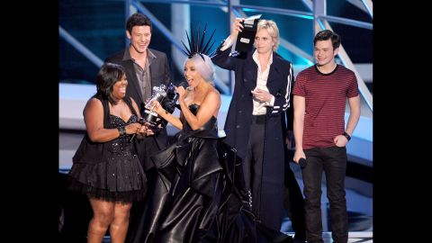 Lady Gaga, center, accepts the Best Pop Video award from actors Amber Riley, Cory Monteith, Jane Lynch and Chris Colfer at the 2010 MTV Video Music Awards.