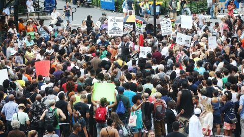 People gather at a rally honoring Trayvon Martin at Union Square in New York on July 14.
