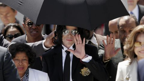 """<a href=""""http://www.cnn.com/2005/LAW/06/13/jackson.trial/index.html"""">Michael Jackson</a>, flanked by family members, waves after his 2005 acquittal on child molestation charges in Santa Maria, California. If convicted, the late pop icon would have faced nearly 20 years in prison. Jackson died in June 2009 while getting ready for a new tour."""
