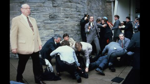 A chaotic scene ensues after the assassination attempt.