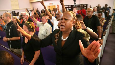 Residents of Sanford, Florida, attend a prayer vigil to promote peace and unity in their city in the wake of the George Zimmerman trial on July 15.