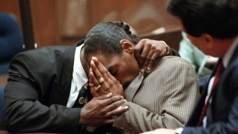 """Rapper <a href=""""http://www.cnn.com/US/9602/snoop/"""">Snoop Dogg</a>, whose real name is Calvin Broadus, is embraced by his former bodyguard McKinley Lee in 1996 after they were both acquitted of murder charges in the shooting death of an alleged gang member. Ironically, a music video released before the trial for the song """"Murder Was the Case"""" features Snoop as a man who kills someone in self-defense and is then convicted of murder."""