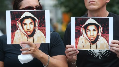 People hold photos of Trayvon Martin at a rally honoring the teenager on July 14, 2013, in New York after George Zimmerman's acquittal.