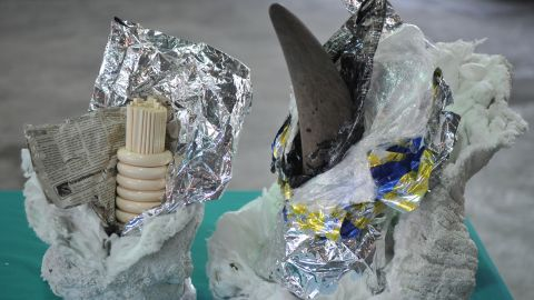 A rhino horn and ivory chopsticks and bracelets are all on display at Hong Kong's Customs and Excise Department offices on November 15, 2011, after authorities seized a container shipped from South Africa.