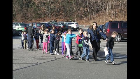 """Connecticut State Police evacuate <a href=""""http://www.cnn.com/2012/12/14/us/connecticut-school-shooting/index.html"""" target=""""_blank"""">Sandy Hook Elementary School</a> in Newtown, Connecticut, in December 2012. Adam Lanza opened fire in the school, killing 20 children and six adults before killing himself. Police said he also shot and killed his mother in her Newtown home."""