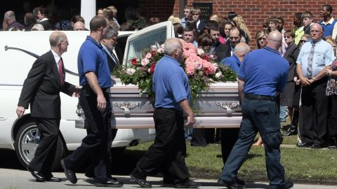 """Pallbearers carry a casket of one of <a href=""""http://www.cnn.com/2009/CRIME/03/11/alabama.shooting.timeline/index.html?iref=allsearch"""" target=""""_blank"""">Michael McLendon's</a> 10 victims. McLendon shot and killed his mother in her Kingston, Alabama, home, before shooting his aunt, uncle, grandparents and five more people. He shot and killed himself in Samson, Alabama, in March 2009."""