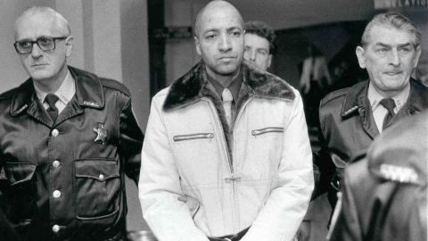 Prison guard George Banks is led through the Luzerne County courthouse in 1985. Banks killed 13 people, including five of his children, in Wilkes-Barre, Pennsylvania, in September 1982. He was sentenced to death in 1993 and received a stay of execution in 2004. His death sentence was overturned in 2010.