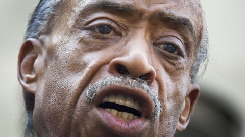 The Rev. Al Sharpton calls for a full federal investigation of the Martin killing, saying mere remarks by President Barack Obama and others weren't enough, outside the U.S. Justice Department in Washington on July 16.