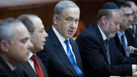 Israeli Prime Minister Benjamin Netanyahu looks over during the weekly cabinet meeting in his Jerusalem office on July 14.