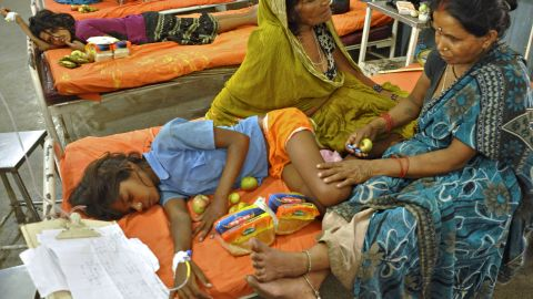 Indian schoolchildren, who consumed a free mid day meal at a school in the Saran district of Bihar state, recuperate at a ward after receiving fruits and bread at the Patna Medical College and Hospital in Patna on July 18, 2013. Thousands of school children were refusing free meals in poverty-stricken eastern India, fearful of being poisoned, after 22 children died from eating lunch apparently contaminated with insecticide, officials said July 18.