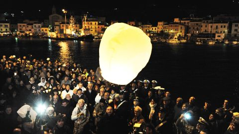 Survivors, grieving relatives and locals release lanterns into the sky in Giglio after a minute of silence on January 13, 2013, marking the one-year anniversary of the shipwreck. The 32 lanterns -- one for each of the victims -- were released at 9:45 p.m. local time, the moment of impact.