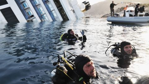 Members of the Italian coast guard conduct a search-and-rescue mission on January 21, 2012.
