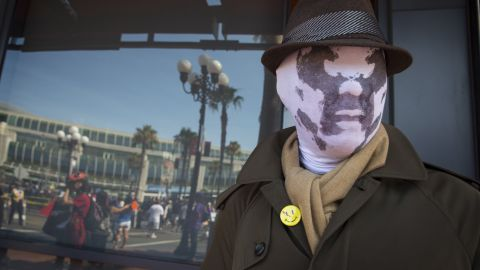 """Cosplayer Noel Victorio is dressed as Rorschach from the graphic novel """"Watchmen"""" on July 18."""