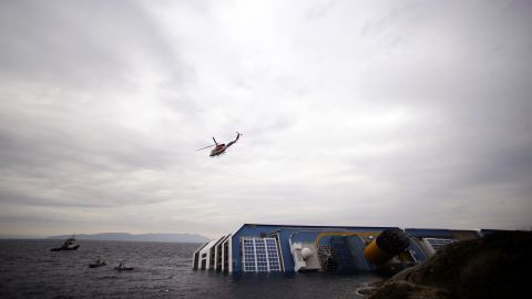 Rescuers search the waters near the stricken ship on January 16, 2012.