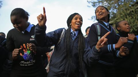 JOHANNESBURG, SOUTH AFRICA - JULY 18: Schoolchildren sing 'Happy Birthday' to former South African President Nelson Mandela at Phefeni High School, opposite Mandela's former home in Soweto Township on July 18, 2013 in Johannesburg, South Africa. The South African presidency has said that Mandela's health is 'steadily improving', as the anti-apartheid icon spends his 95th birthday in hospital. Children in schools across the country have started off Mandela Day by singing 'Happy Birthday' to him. (Photo by Christopher Furlong/Getty Images)
