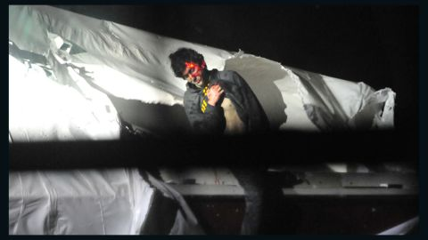 Photos of Boston Bombing Suspect Tsarnaev as he was captured on a boat