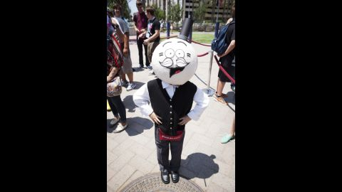 """A fan dressed as Pops from Cartoon Network's """"Regular Show"""" poses for a photo on July 18."""