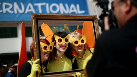 """Three women dressed as characters from Cartoon Networks """"Venture Bros."""" pose for a photo on July 19."""
