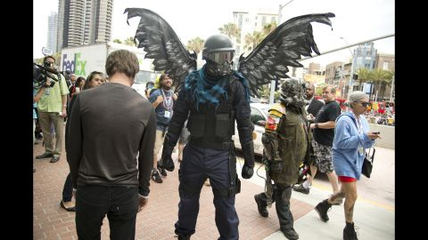 """Attendee Connor Sullivan, an artist and prop builder, dressed as a character inspired by the """"My Little Pony"""" franchise during Comic-Con on Friday, July 19."""
