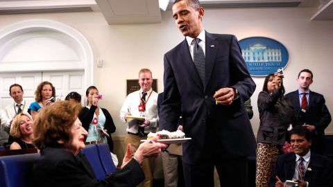 Obama surprises Thomas with cupcakes to celebrate her birthday in the White House briefing room on August 4, 2009. Thomas and Obama share the same birthday.