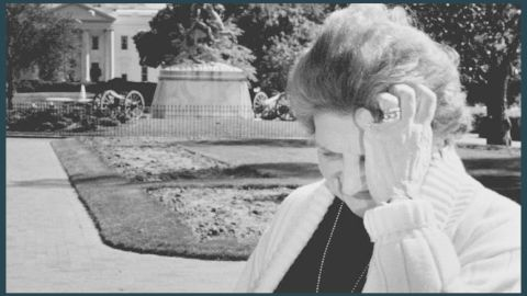 Thomas pauses during a television interview in front of the White House on May 12, 1992.