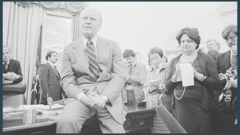 Thomas takes notes as President Gerald Ford speaks to reporters in Washington on September 30, 1976.