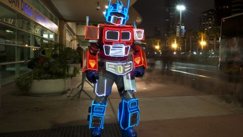 """A convention-goer dressed as Optimus Prime from the """"Transformers"""" franchise walks outside of the convention center on July 20."""