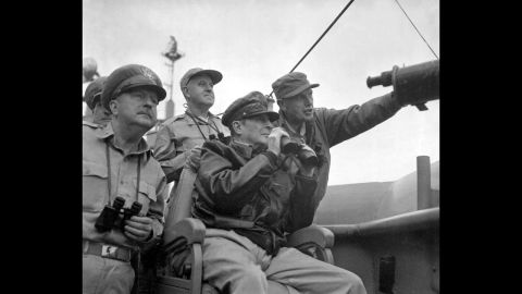Gen. Douglas MacArthur, center, and other U.S. military personnel observe the shelling of Inchon from the U.S.S. Mt. McKinley, on September 15, 1950.