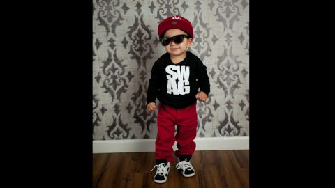"""Tara Thackeray took this photo of the quintessential kid with swagger -- even wearing a """"swag"""" T-shirt."""