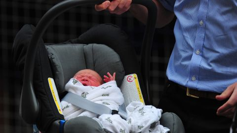 Prince William and Catherine, Duchess of Cambridge's new-born baby boy is introduced to the world's media outside the Lindo Wing of St Mary's Hospital in London on July 23, 2013. The baby was born on Monday afternoon weighing eight pounds six ounces (3.8 kilogrammes). The baby, titled His Royal Highness, Prince (name) of Cambridge, is directly in line to inherit the throne after Charles, Queen Elizabeth II's eldest son and heir, and his eldest son William.   AFP PHOTO / CARL COURT CARL COURT/AFP/Getty Images
