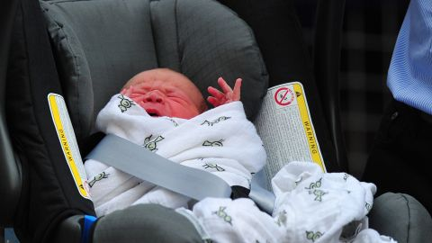 The newborn sits in his car seat for the ride home.