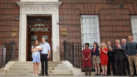 The new parents stand in front of the Lindo Wing of the hospital on July 23, 2013.