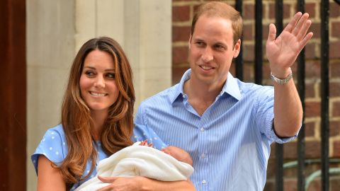 Prince William (R) and Catherine, Duchess of Cambridge show their new-born baby boy to the world's media outside the Lindo Wing of St Mary's Hospital in London on July 23, 2013