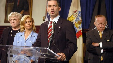 """Former New Jersey Gov. Jim McGreevey, with his then-wife Dina Matos standing by, told a packed news conference in August 2004: """"My truth is that I am a gay American"""" and that he had engaged in a consensual affair with his homeland security adviser, who had threatened to sue him for sexual harassment."""