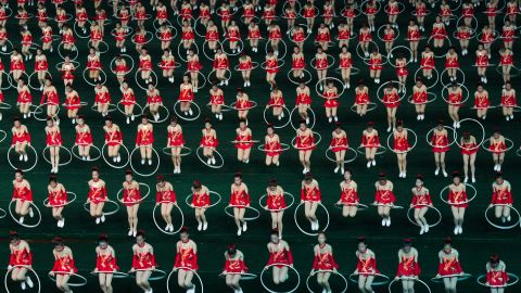 """Women jump through hula hoops during the opening night of the annual Arirang Festival, or """"mass games,"""" at Pyongyang's May Day Stadium on Monday, July 22."""