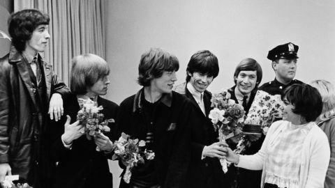 The Rolling Stones receive bouquets from fans in New York during their first US tour in June 1964.