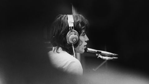 """Jagger sits in a London recording studio during the filming of director Jean-Luc Godard's """"Sympathy For the Devil"""" in 1968."""