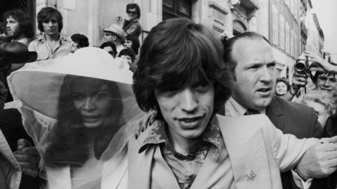 Jagger and his new bride, Bianca Perez Morena de Macias, make their way through the crowds on their wedding day in St. Tropez, France, in 1971.