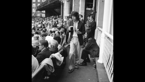 Jagger returns to his seat during a cricket match between England and Australia in 1972.